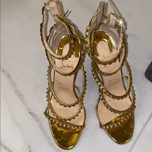 Christian louboutin gold strappy sandal heel.